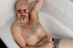 Gasper Johnson strokes cock in the bath tub